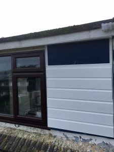 Shiplap cladding is fitted