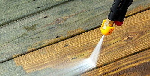 Pressure washing some wooden decking