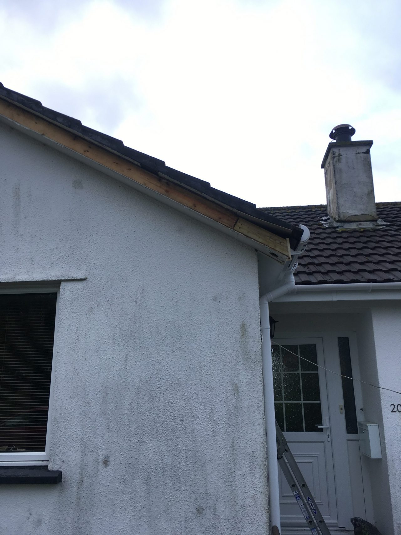 White Fascias Soffits And White Half Round Guttering In