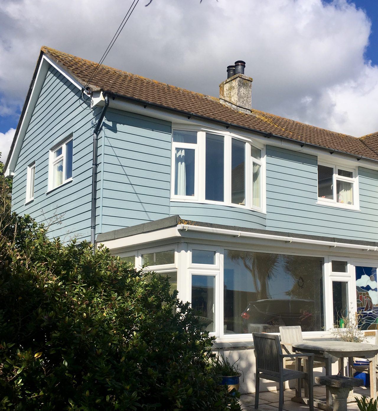 Blue Grey Cedral Cladding To A House In Praa Sands