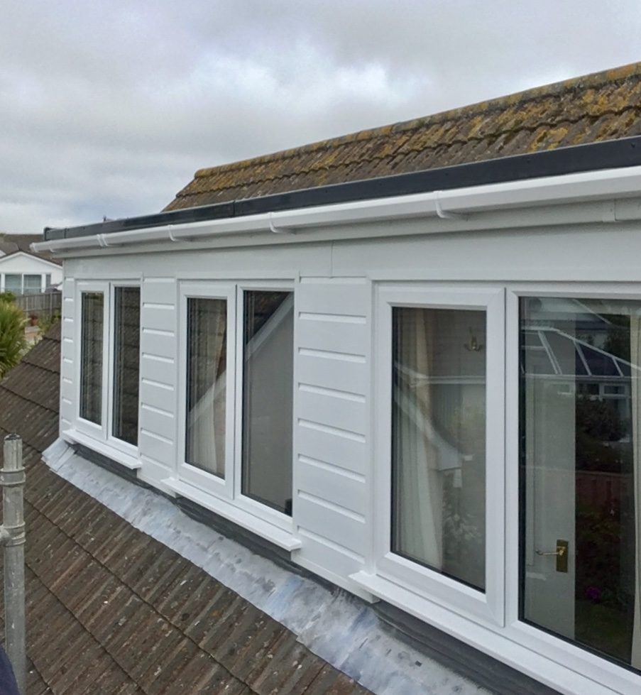 White Shiplap Cladding And White Fascias On A Dormer With