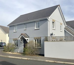 Finished picture of the painted house in dove grey
