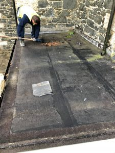 wet and poor flat roof being removed.