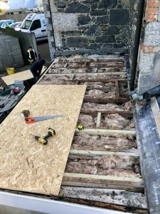 tiles removed and new OSB laid with 4 x 2 beams ready for the flat roof.