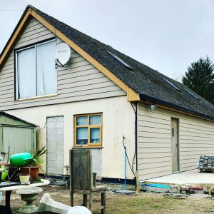 Side gable end covered in Cedral C03 lap cladding