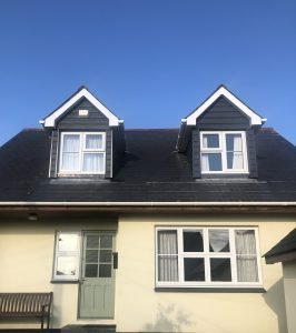 C18 slate grey cedral lap finished on a pair of dormer windows