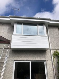White half round guttering and down pipes