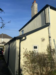 Black square guttering and down pipes